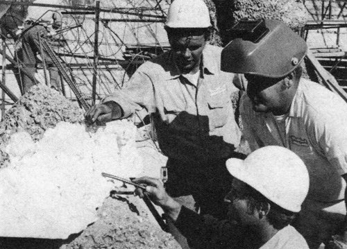 Tony Barter first built plaster models of the rock formations being constructed on the west wall to guide the workmen. Pictured here are Mike Kopach (foreground), Louis Chancey (center) and Ervin Rouse (back) studying one portion of the model in  preparation to welding iron rods into place for the real thing.
