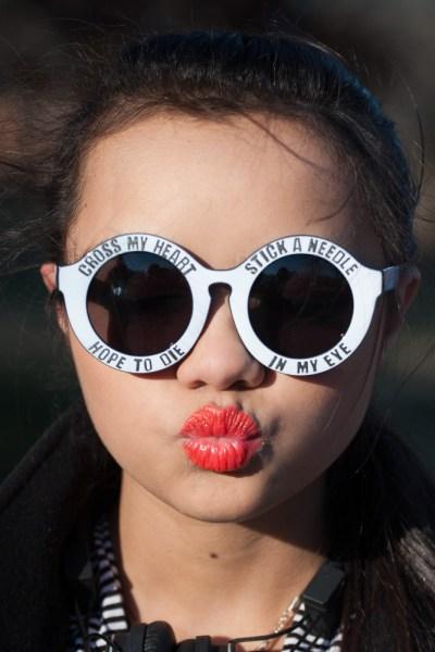 Glasses--$10, SunglassSpot.com. Orange Lipstick--$7, Maybelline.
