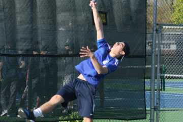 40-LOVE: Sophomore Peter Velic hits a ball in an attempt the return over his head. Velic and his partner senior Adam Nadler are the first doubles team for the boys' varsity tennis team. The two are also the only pairing that won their matchup against Hersey on May 3 as the team dropped to the Huskies 6-1.