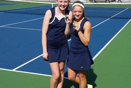Juniors Colleen Stanford and Annie Walsh stand with their medals after winning fifth place at third doubles in the MSL Conference Meet in October of 2015. The team finished fifth overall in the MSL, but the team knows that they can do even better this season.