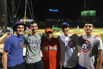 Writer Jack Ankony (center), a junior, and his friends pose with the Marlins Man at a Cubs game at Wrigley.