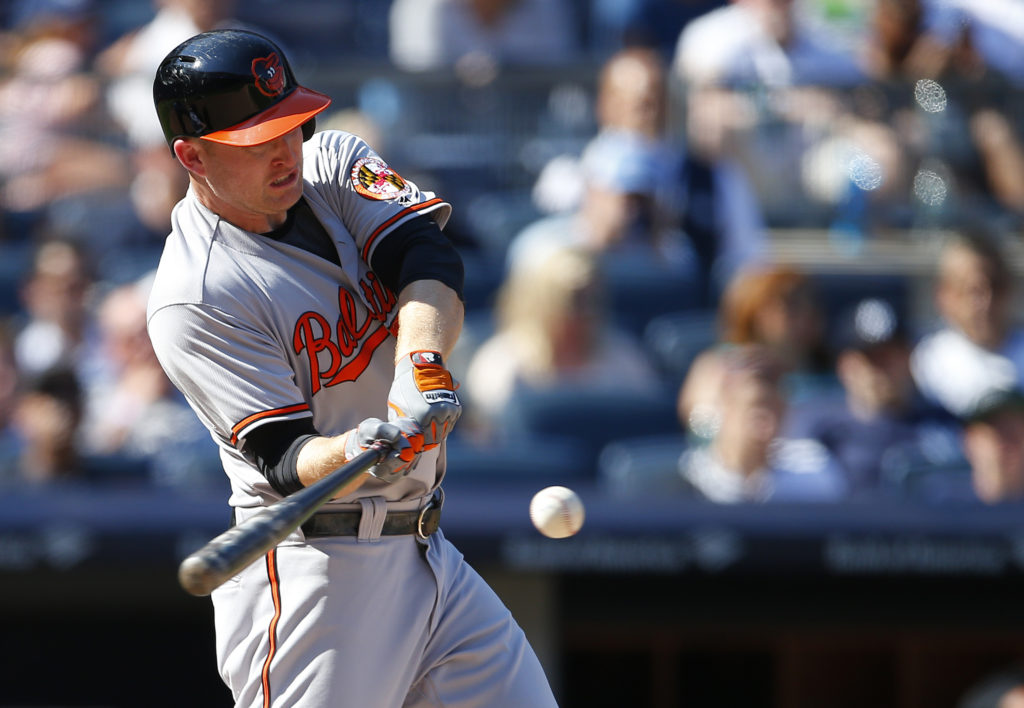 NEW YORK, NY - AUGUST 28: Mark Trumbo #45 of the Baltimore Orioles hits a home run during the eighth inning of a game against the New York Yankees at Yankee Stadium on August 28, 2016 in the Bronx borough of New York City.   Rich Schultz/Getty Images/AFP