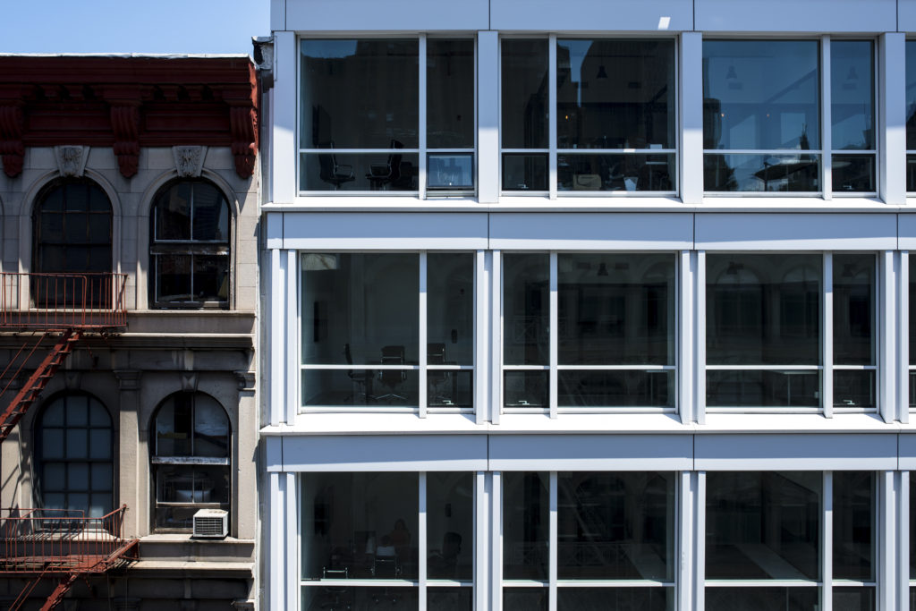 The new six-story co-working office building at 433 Broadway in New York, June 7, 2016. After demolition of the one-story bank building on he site was approved in 2002, the developer first planned a hotel, but then switched to an office building with a steel frame and a facade made of Alucobond, aluminum sheets bonded to a polyethylene core. (Karsten Moran/The New York Times)