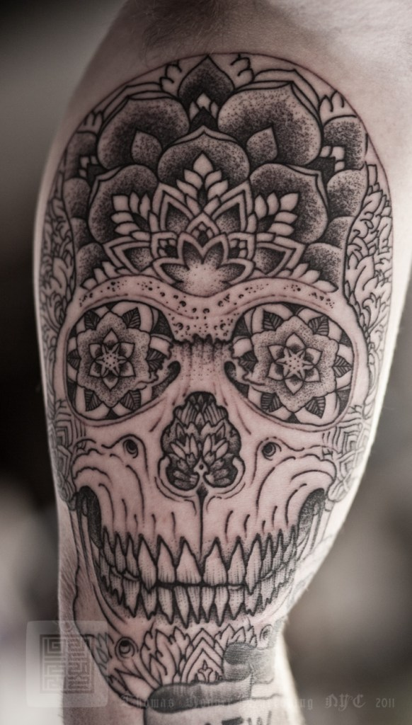 A trippy skull design by Thomas Hooper. He does the most incredibly intricate blackwork, be sure to look up more of his work.