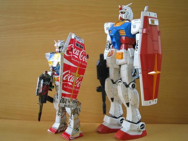4. Gundam robot made from cans next to an actual Gundam robot action figure.
