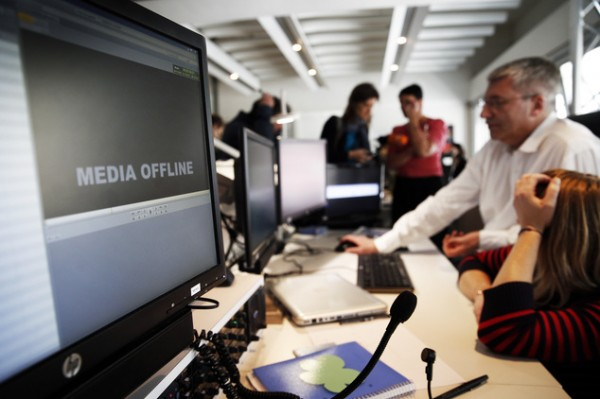 TV5  employees work after the French television network was hacked by people claiming allegiance to the Islamic State group, in Paris, France, Thursday April 9, 2015.  The hackers briefly cut transmission of 11 channels belonging to TV5 Monde and took over its websites and social media accounts.  (AP Photo/Christophe Ena)