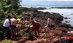3 people swept off rocks