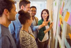 Lean Workshop happy employees brainstorm