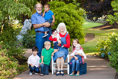 Photos of the grandparents and six (6) grandchildren as a legacy photo in Everett Washington. Family Portraits in Everett Washington's Evergreen Arboretum at Legion Park by PureShots Photography by Christi Hardy
