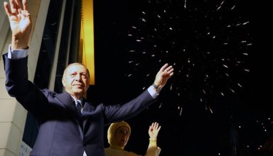 ANKARA, TURKEY - JUNE 25: President of Turkey and leader of the Justice and Development Party (AK Party) Recep Tayyip Erdogan (L) and his wife Emine Erdogan (R) greet the crowd from the balcony of the ruling AK Party's headquarters as fireworks illuminate the sky following his election success in presidential and parliamentary elections in Ankara, Turkey on June 25, 2018.  (Photo by Kayhan Ozer/Anadolu Agency/Getty Images)