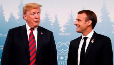U.S. President Donald Trump talks with France's President Emmanuel Macron in a bilateral meeting at the G7 Summit in in Charlevoix, Quebec, Canada, June 8, 2018. REUTERS/Leah Millis