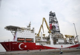 epa07660241 Workers wait in front of the Turkish drilling vessel Yavuz at Dilovasi port in city of Kocaeli, Turkey, 20 June 2019. Turkey's second drilling ship will operate off the Karpas Peninsula to the northeast of the island of Cyprus. Yavuz will be determined by geology and geophysics studies of the vessel and it will take place at a depth of approximately 1,000 meters on the seabed and some 3,000 meters of drilling will be made, Bilgin said, adding that the ship will move to its second location once the first drill is completed.  EPA/ERDEM SAHIN