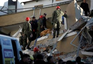 Emergency personnel work at the site of a collapsed building in Durres, after an earthquake shook Albania, November 26, 2019. REUTERS/Florion Goga