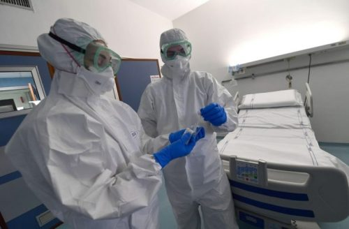 epa08179917 Medical staff of S. Martino hospital infectious disease department, with protective equipment on the isolation room, Genoa, Italy, 30 January 2020. The coronavirus, called 2019-nCoV, originating from Wuhan, China, has spread to all the 31 provinces of China as well as more than a dozen countries in the world. The outbreak of coronavirus has so far claimed at least 170 lives and infected more than 8,000 others, according to media reports.  EPA/LUCA ZENNARO