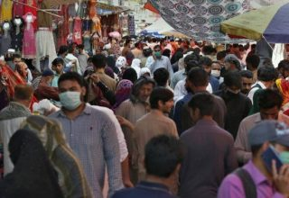 People shop at a busy market after the government relaxed the weeks-long lockdown that was enforced to help curb the spread of the coronavirus, in Rawalpindi, Pakistan, Wednesday, May 13, 2020. (AP Photo/Anjum Naveed)