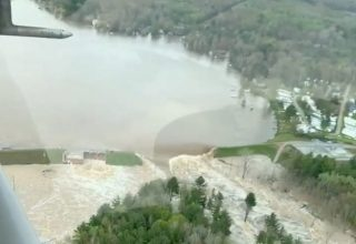 Aerial view of water from a broken Edenville Dam seen flooding the area as it flows towards Wixom Lake in Michigan, U.S. in this still frame obtained from social media video dated May 19, 2020. RYAN KALETO/via REUTERS THIS IMAGE HAS BEEN SUPPLIED BY A THIRD PARTY. MANDATORY CREDIT. NO RESALES. NO ARCHIVES. MUST ON SCREEN COURTESY RYAN KALETO