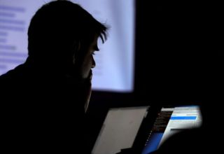A man takes part in a hacking contest during the Def Con hacker convention in Las Vegas, Nevada, U.S. on July 29, 2017. REUTERS/Steve Marcus
