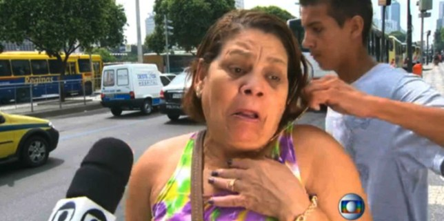 Brazilian Woman Mugged During a TV Interview