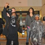 Despite occasional rain, about 100 people gathered outside the Charlotte-Mecklenburg Police Department headquarters to protest the killing of Keith Scott and the Mecklenburg County district attorney's decision to not prosecute the officer who shot him, November 30, 2016. (Photo: Glenn H.Burkins)