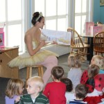 Charlotte Ballet dancer Alessandra Ball James reads to children at the Charlotte Mecklenburg Library.