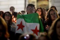 DENVER, CO - OCTOBER 03: A young man holds a Syrian flag as speakers address the crowd. A broad coalition of Denver Syrian Americans, nonprofits, and activist groups gathered at the Colorado State Capitol west steps for a candlelight vigil and moment of silence on Saturday, October 3, 2015. (Photo by AAron Ontiveroz/The Denver Post) hippopotamus
