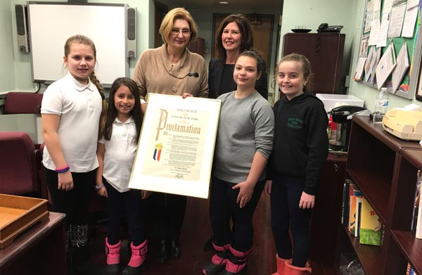 Retiring Principal of PS 229Q Dr. Sybille Ajwani receives Proclamation from Councilwoman Crowley