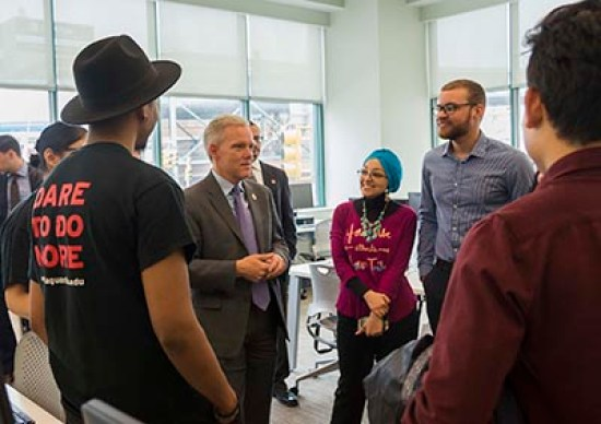 Councilman Jimmy Van Bramer talkin to students at LaGuardia Community College at the expanded library.