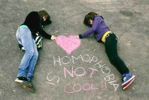 Homophobia is not cool, chalked onto a playground by two school children