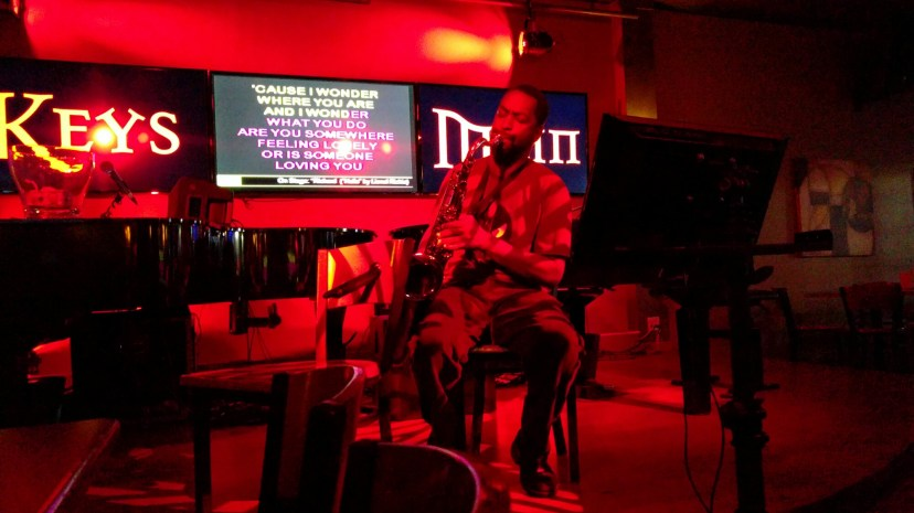Richard plays a saxophone cover of 'hello' during karaoke night at Keys on Main in Salt Lake City on Tuesday, Aug. 9, 2016.