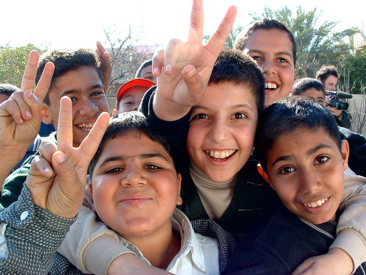 Young Iraqi boys showing the peace sign Quick Me Ups