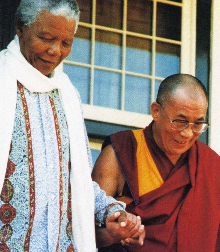 Nelson Mandela and Dalai Lama holding hands, tolerance. Quick Me Ups