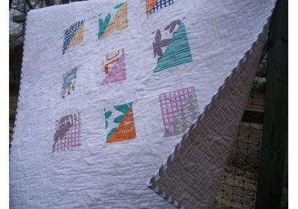 Tipsy Triangles quilt outside