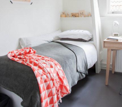 boy's bedroom with quilt top