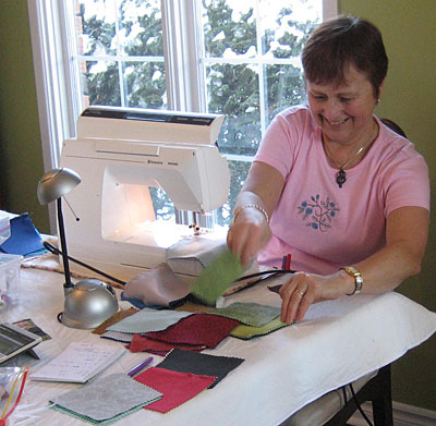 Frances sewing nine patch blocks.