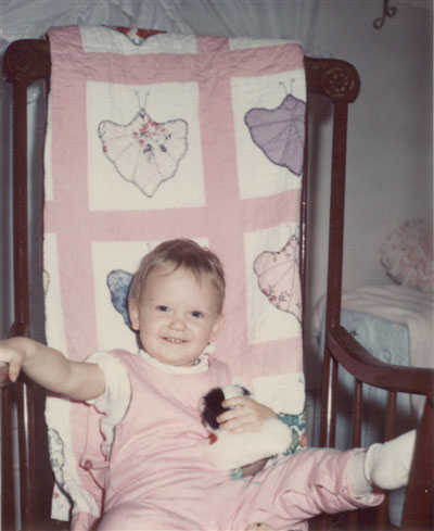 Heidi Kaisand Toddler with Quilt