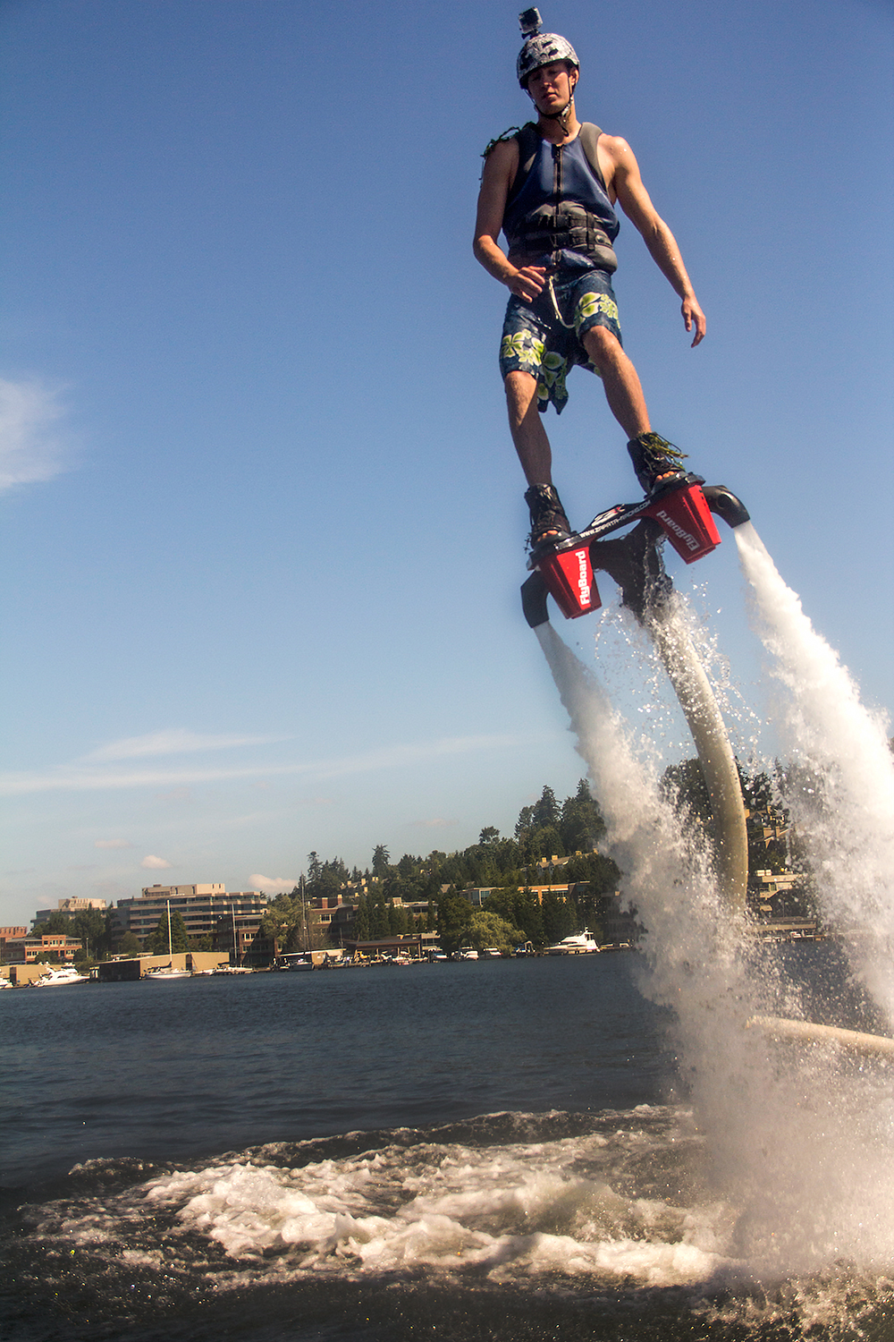 Sport Flying Flyboard Sends Rider Flying Out Of Water Soaring Through Air