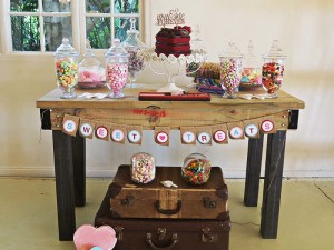 Candy buffet on rustic table - Quirky Parties