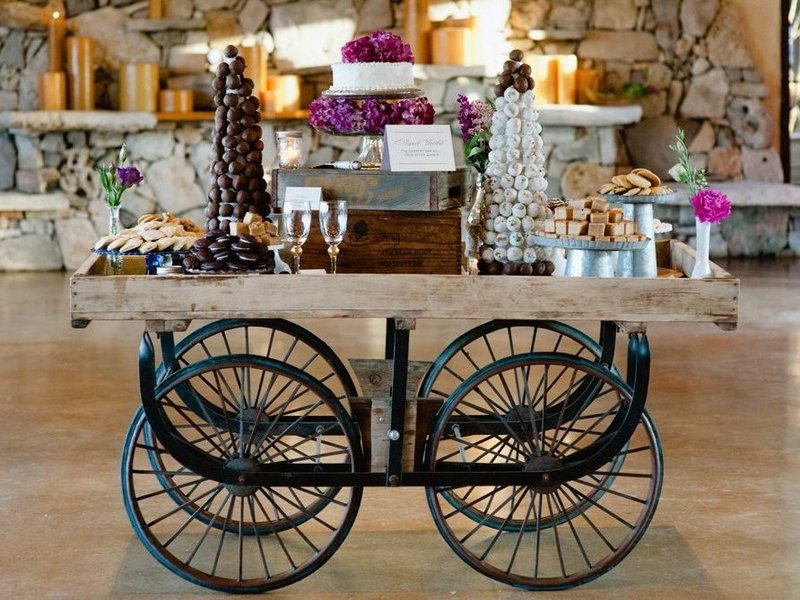 Dessert table display on farm wagon - Quirky Parties