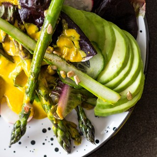 Asparagus salad with turmeric tahini dressing.