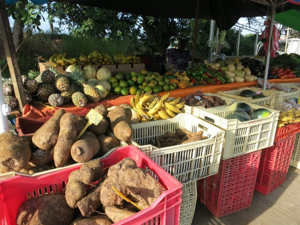 a market stall with a variety of fruit and vegetables in Guadeloupe
