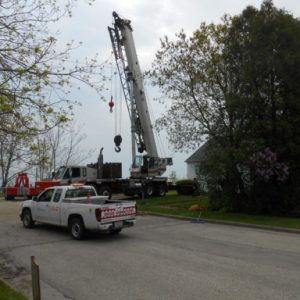 Mount Pleasant resident Andrew Hartnell hired a crane to move rip rap into place at the bottom of the bluff on which his home sits.