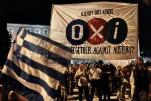 479583042-people-celebrate-in-front-of-the-greek-parliament-as_1.jpg.CROP.promovar-mediumlarge