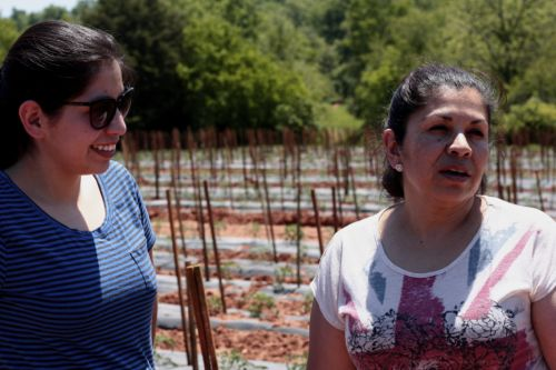 Martha Calderon (right) with her daughter on her farm in Vale, NC.