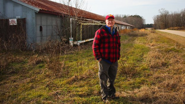 Benny Bunting stands in front of his old chicken house in Oak City, NC. Photo by Dan Charles, National Public Radio