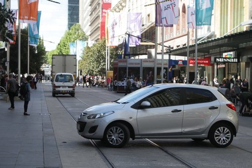 Car number three executes a u-turn to head back down the Bourke Street Mall