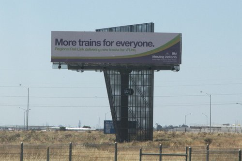 'Moving Victoria' billboard promoting Regional Rail Link beside the Deer Park bypass at Caroline Springs