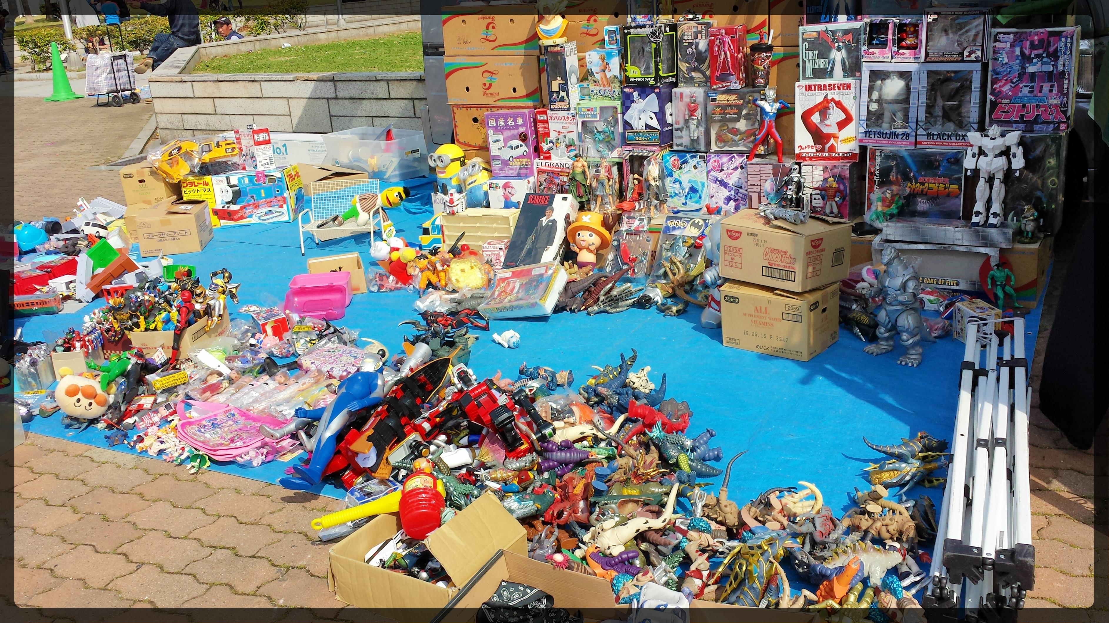 Flea Market at Meriken in Motomachi, Kobe. Toys and figurines for sale.