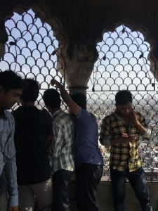You climb up 134 steps to the top. Its round and circular and winding. No place to rest or catch your breath. On top the minar arches are enclosed with wire mesh
