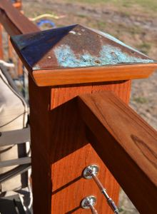 Douglas fir post with patina copper cap.