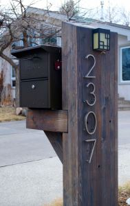 Custom mailbox made of heavy timbers.
